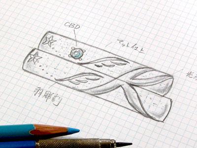 イニシャルKと羽の結婚指輪デザイン画